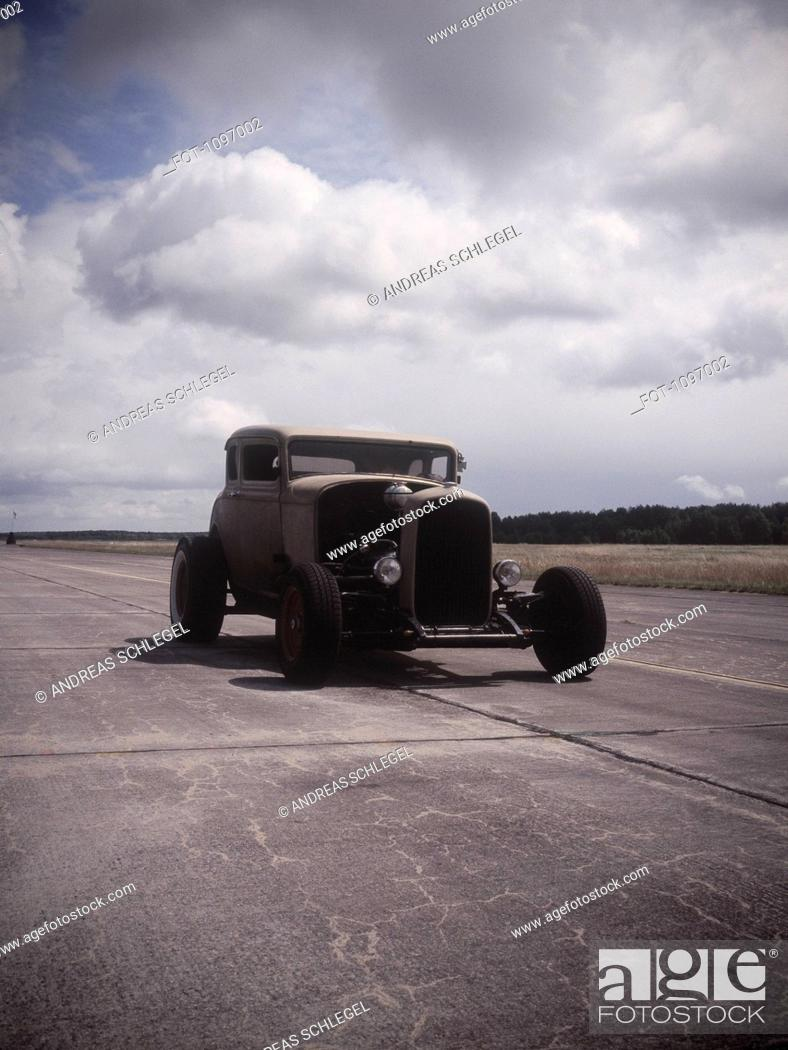Stock Photo: An old car on a race track.