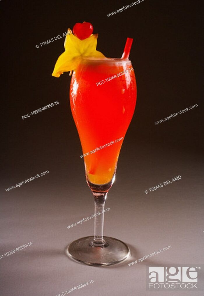 Stock Photo: A tropical drink garnished with fruit.
