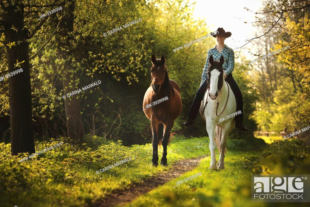 Female Western Rider On A Paint Horse Black Tobiano Colour Pattern Stock Photo Picture And Royalty Free Image Pic Ibk 3939998 Agefotostock