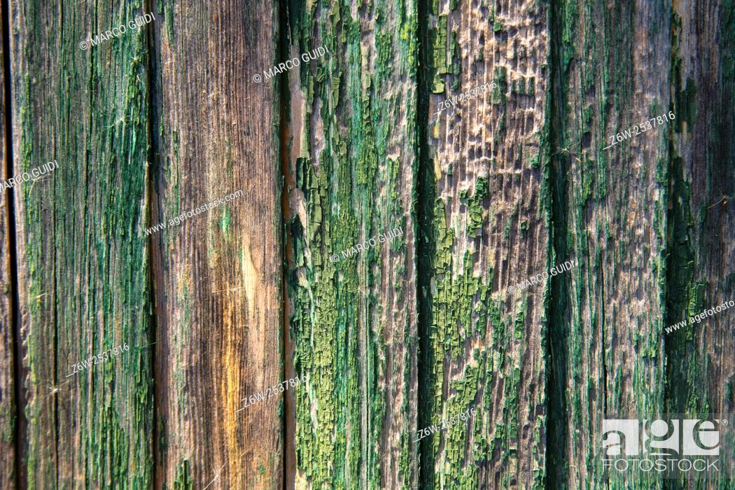 Stock Photo: Outer wall made of old wooden boards colored green.