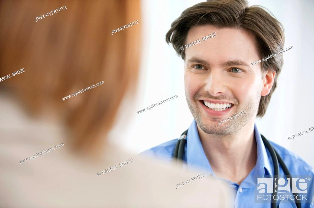 Stock Photo: Doctor looking at a woman.