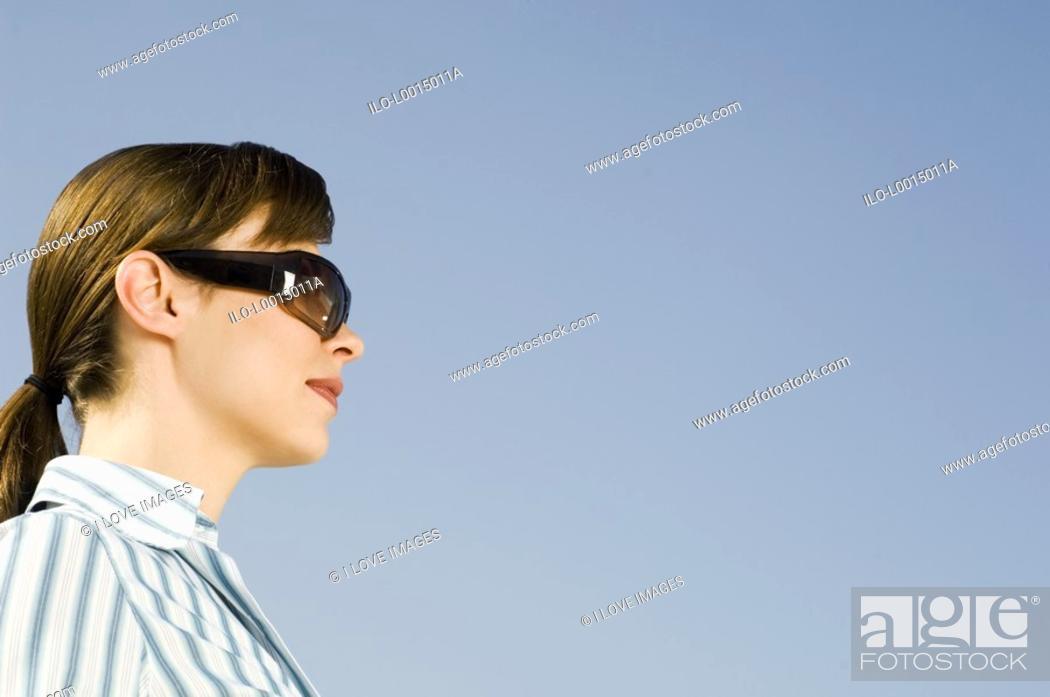 Stock Photo: A businesswoman wearing sunglasses.