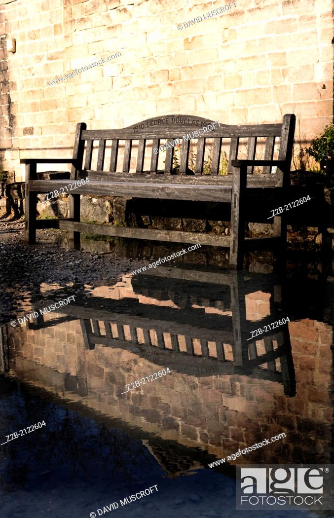 Stock Photo: Bench reflected in pool of water.