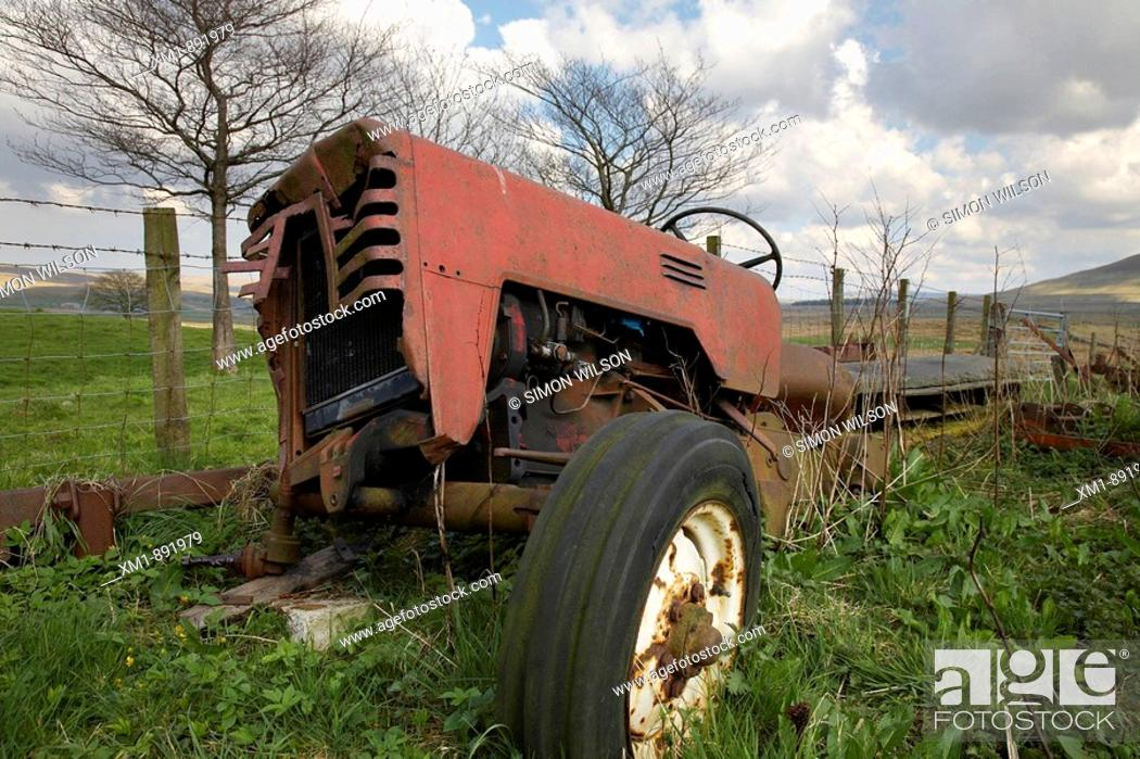 Stock Photo: Disused old tractor in field.