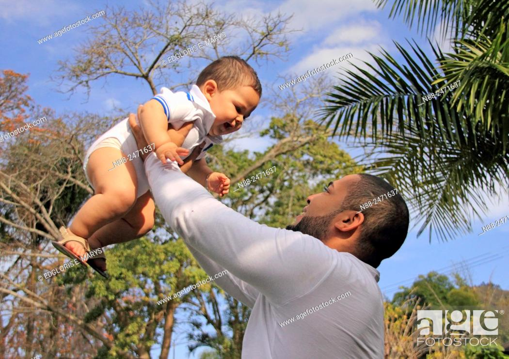 Stock Photo: Latin american father and kid.