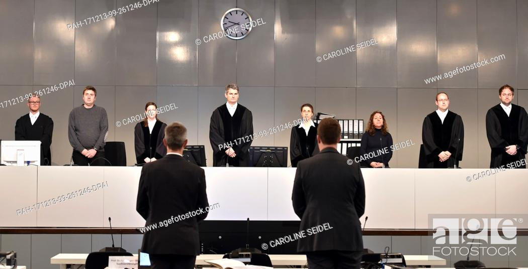 Stock Photo: Judge Mario Plein (4th l) stands in the court room at the Loveparade trial in Duesseldorf, Germany, 13 December 2017. The district court Duisburg rented a hall.