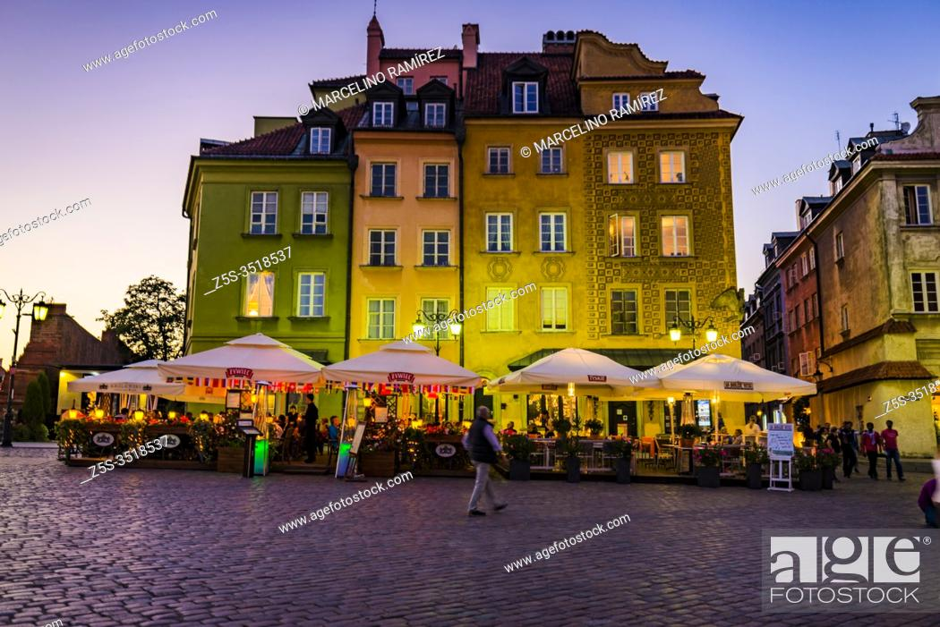 Stock Photo: Historic townhouses at dusk. Castle Square is a historic square in front of the Royal Castle. It is a popular meeting place for tourists and locals.