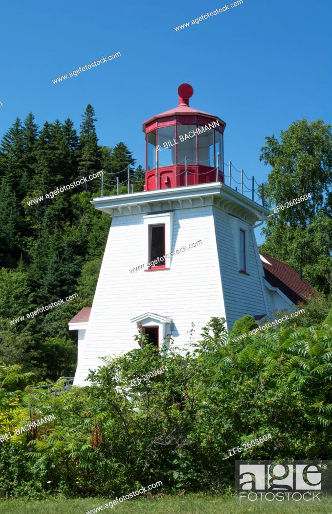 Stock Photo: Canada St Martins New Brunswick white tourist lighthouse in small fishing and lobster village.