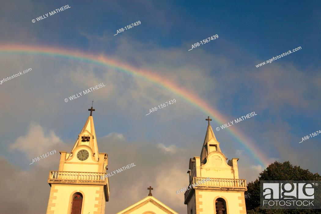 Stock Photo: Church of Nossa Senhora das Neves and rainbow on sky after rainshower at Prazeres, Municipality of Calheta, Madeira, Portugal, Europe.
