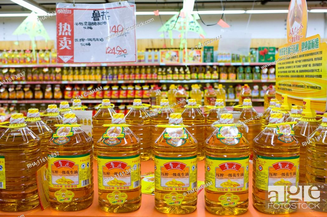 Peanut cooking oil in supermarket, Chongqing, China  The Chinese use