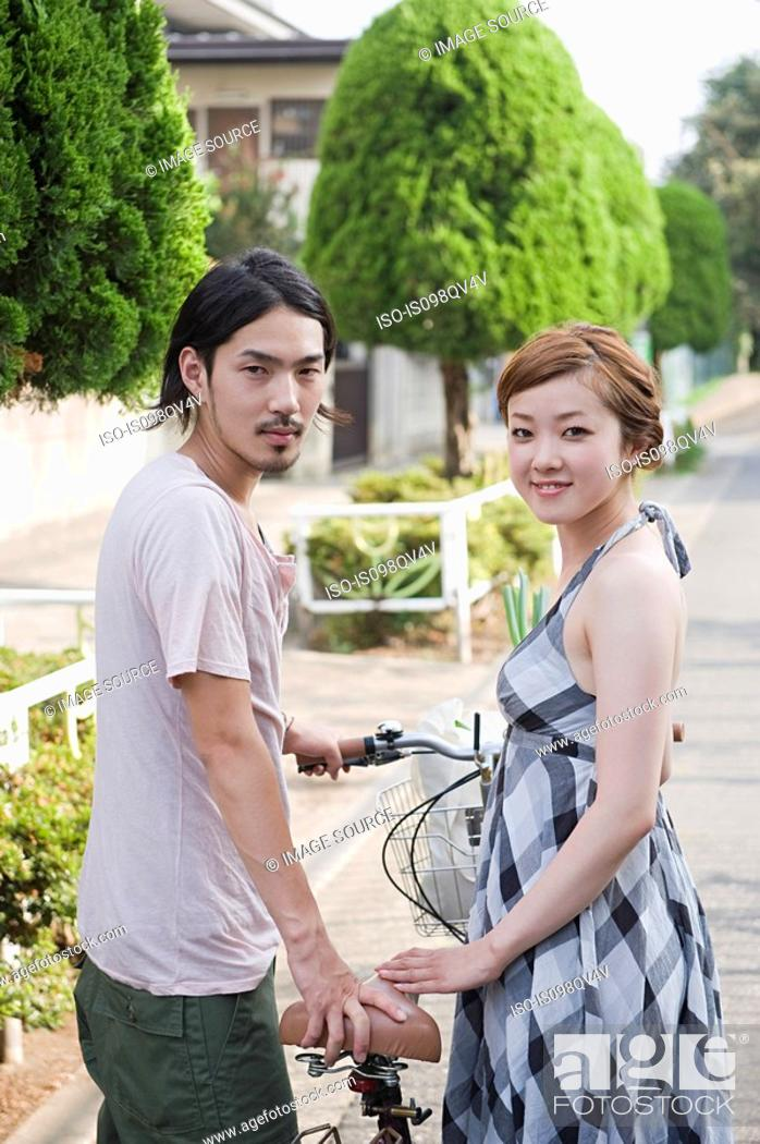 Stock Photo: Young couple on street.