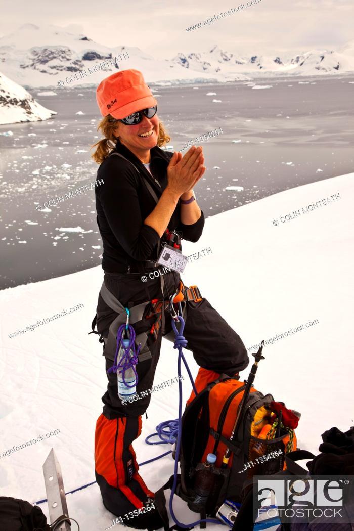 Stock Photo: Climber prepares to set of for ascent Peon Peak, Ronge Island, Antarctic Peninsula.