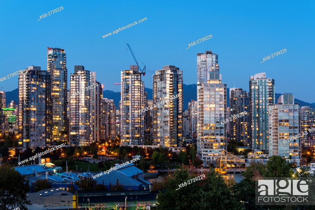 Stock Photo: Apartment towers on the north side of False Creek in the evening, Vancouver, BC, Canada.