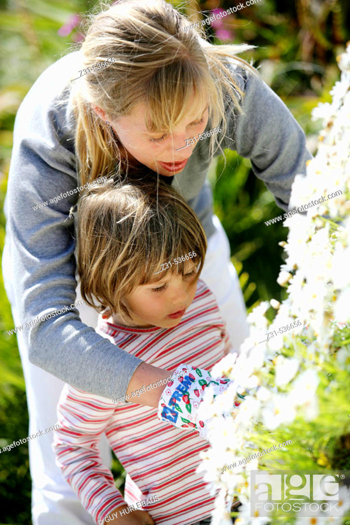 Stock Photo: Zina, Naloen, Standing, Showing , Flowers.