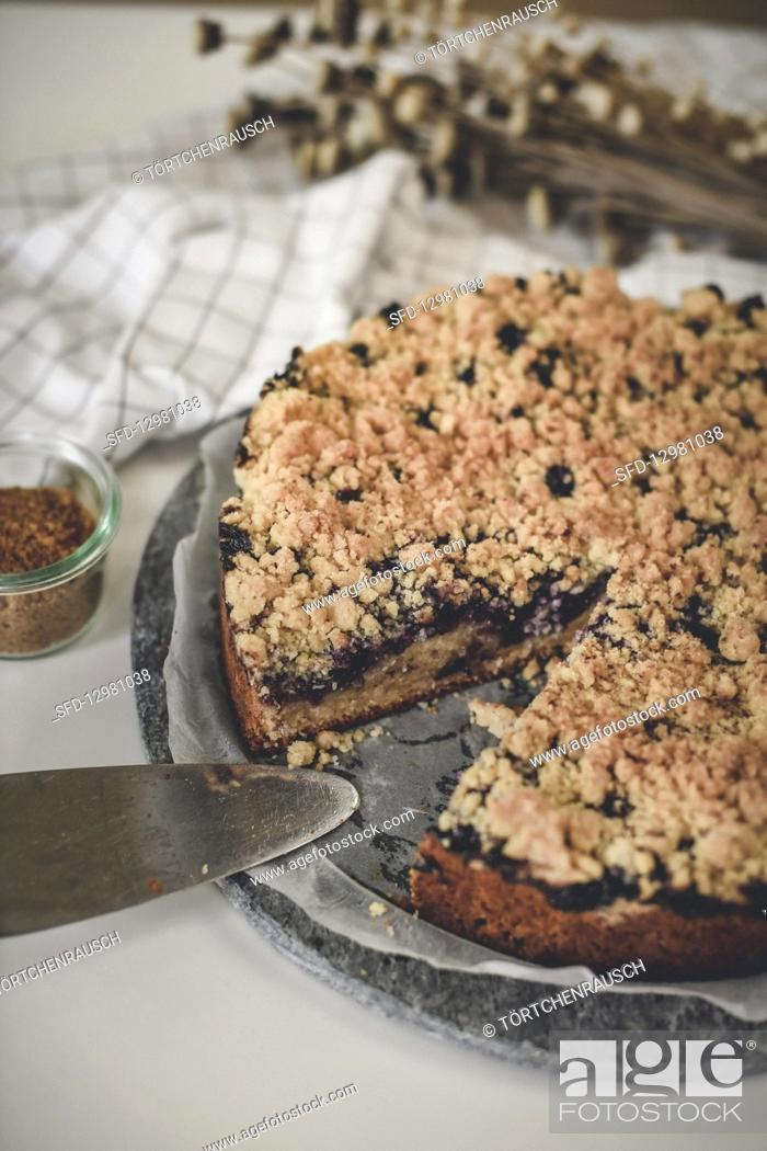 Photo de stock: Blueberry crumble cake made from an oil dough, sliced.