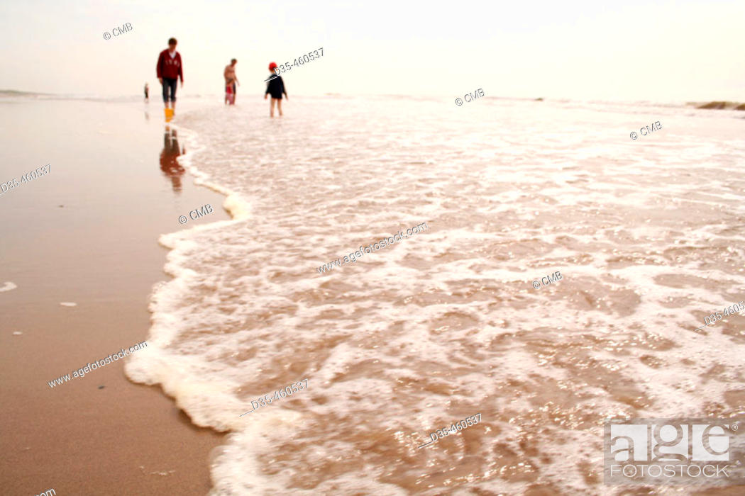 Stock Photo: Family on beach.