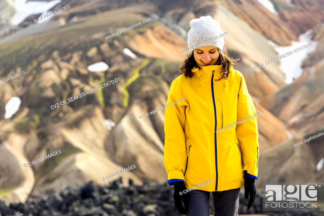 Stock Photo: Young woman hiker walking around Iceland's highlands and mossy hills.