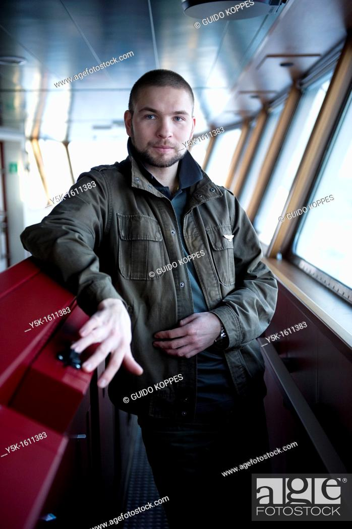 Stock Photo: Baltic Sea near Sweden. Portrait of aRussian steering officer on the bridge of container-vessel MV Flintercape, during a journey from Rotterdam, Netherlands.