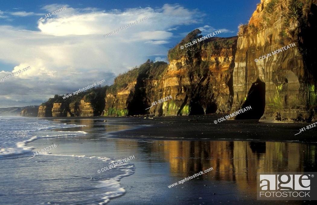 Stock Photo: Late afternoon colours along beach at Tongaporutu, North Taranaki, New Zealand.