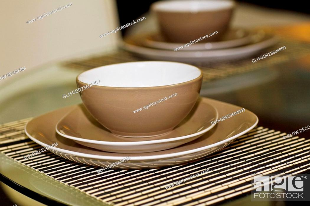 Photo de stock: Bowls and plates on a dining table.