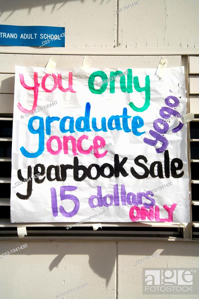 Stock Photo: On graduation day at a Southern California high school, a sign reminds students to buy a yearbook.