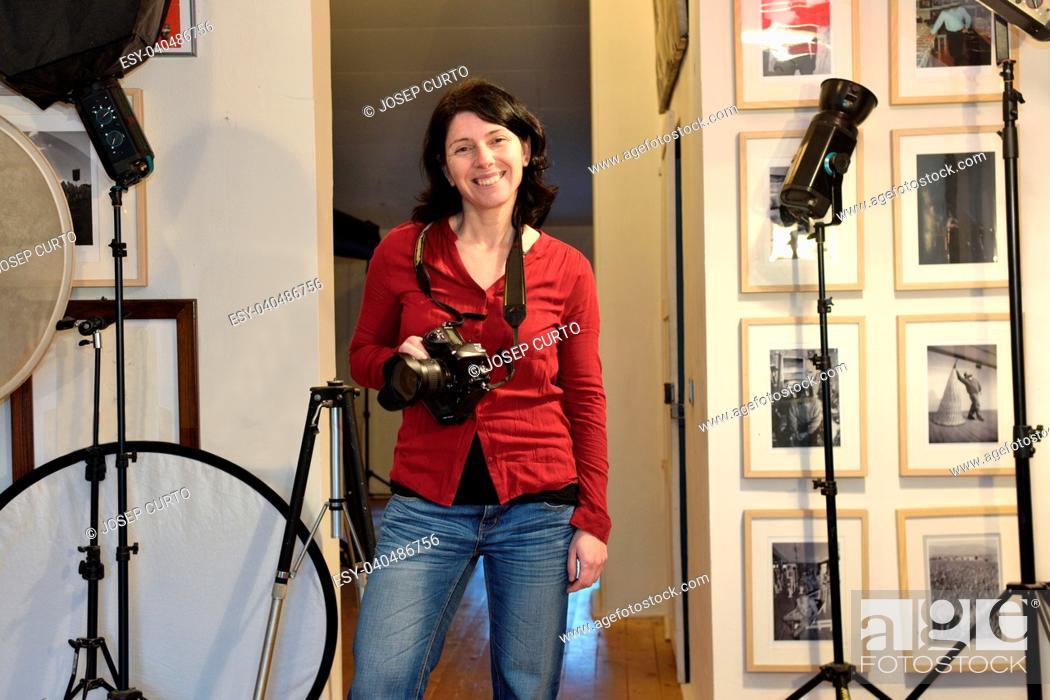 Stock Photo: woman photographer in her photography studio.