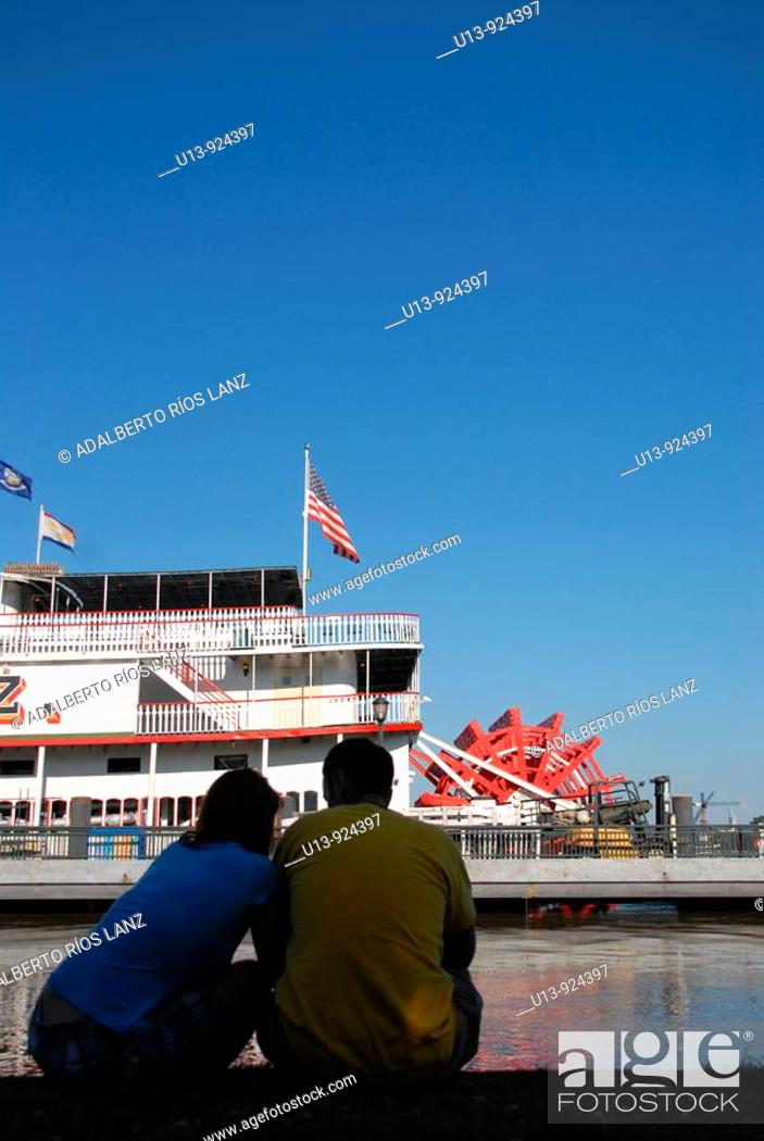 Stock Photo: Couple observing the Natchez Steamboat on the Mississippi riverside, New Orleans, Louisiana, USA.