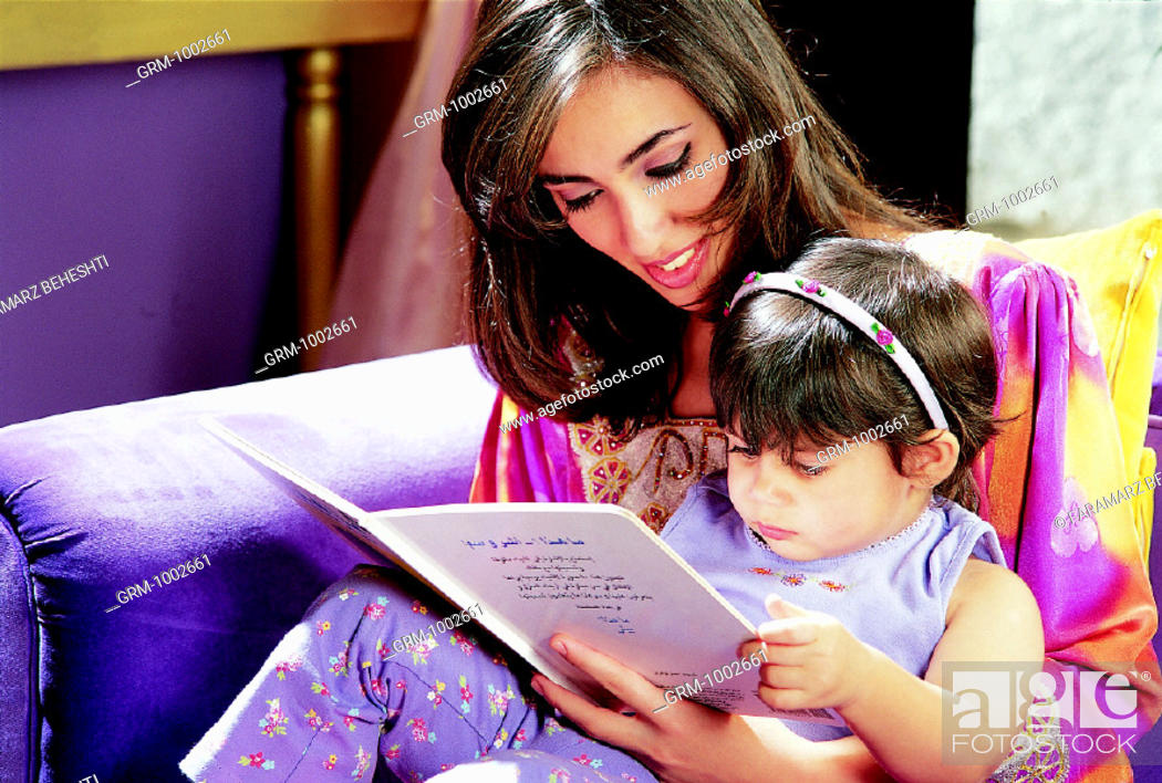 Stock Photo: Mother and daughter reading a book.