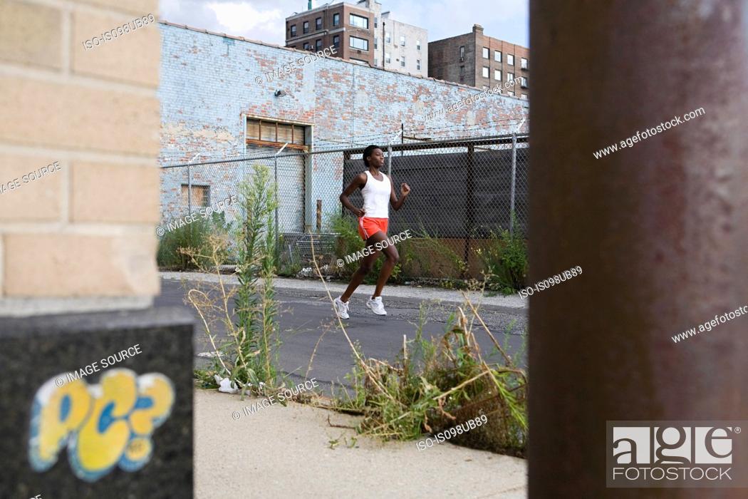 Stock Photo: Woman running in brooklyn.