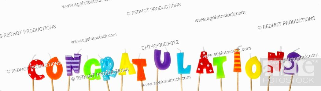 Stock Photo: Candle Letters spelling out congratulations.