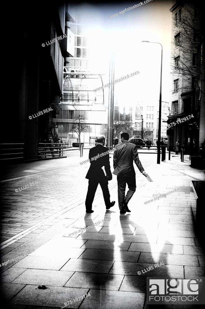 Stock Photo: two executives walking around the City of London, England, UK.