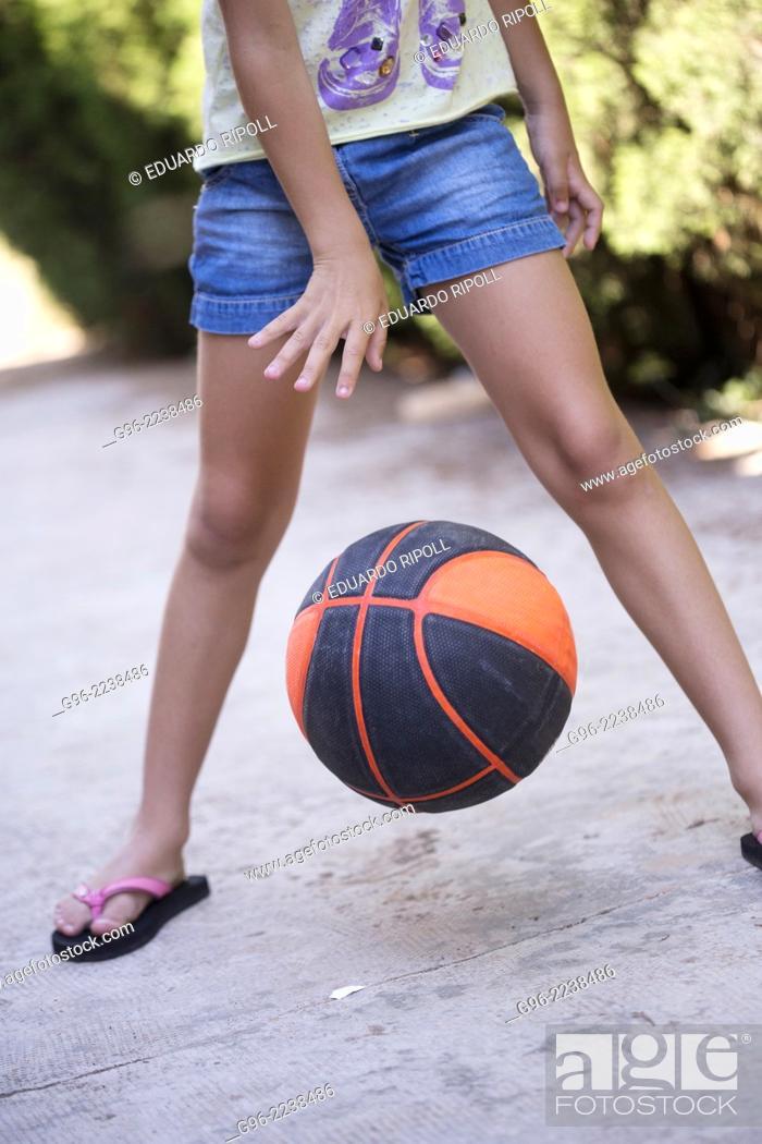 Stock Photo: Girl playing basketball.