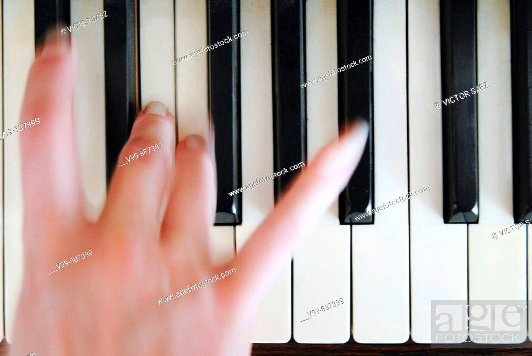 Stock Photo: plays the piano.