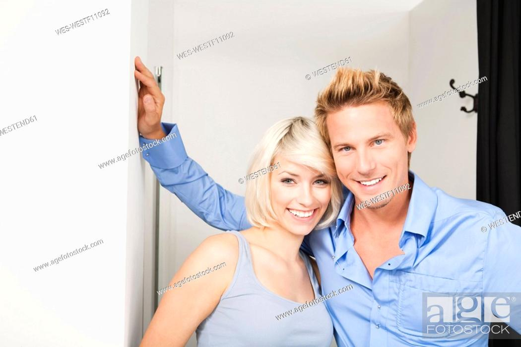 Stock Photo: Young couple in changing room, portrait.
