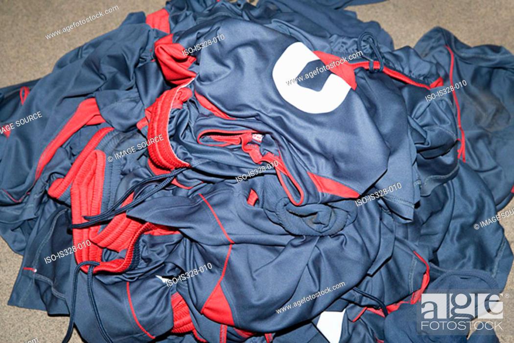 Stock Photo: Pile of football uniforms.