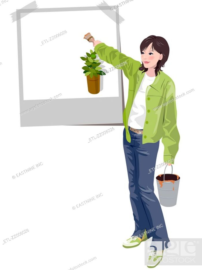 Stock Photo: Woman painting on a poster.