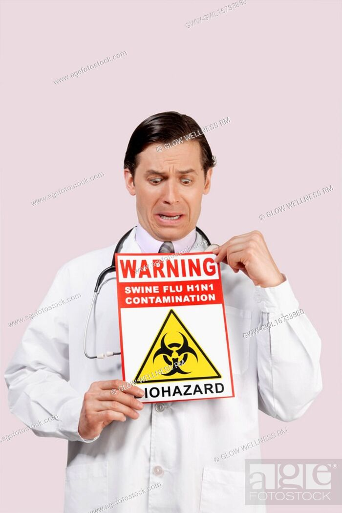 Imagen: Doctor showing a Biohazard warning sign and crying.