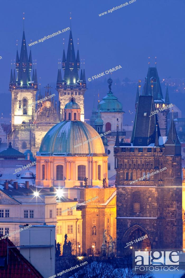 Stock Photo: czech republic, prague - spires of the old town at dusk.