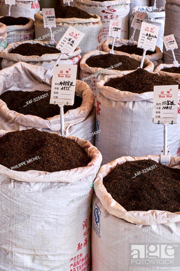Stock Photo: China, Yunnan, Xishuangbanna, tea shop at market.