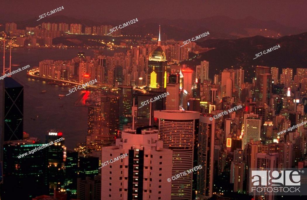 Stock Photo: Aerial view of the lights of Hong Kong skyline and Hong Kong Harbor at night, China.