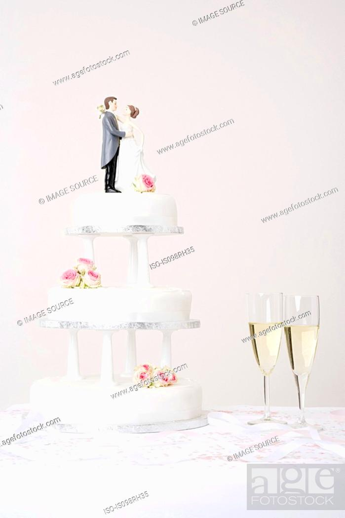 Stock Photo: Wedding cake and champagne.