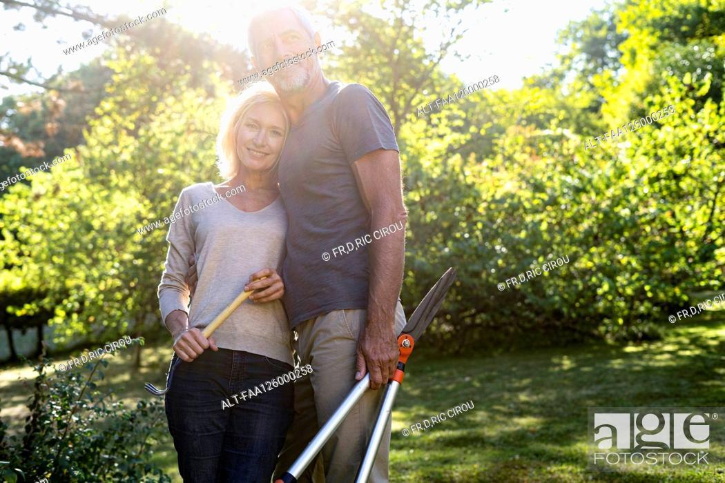 Photo de stock: Portrait of mature couple standing in backyard.