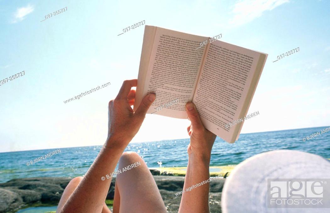 Stock Photo: Reading at the beach.