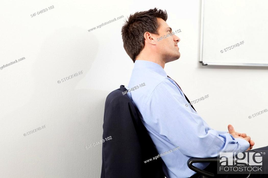 Stock Photo: Pensive businessman in office, Munich, Bavaria, Germany.