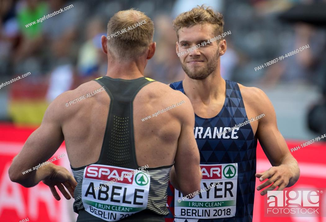 Stock Photo: 07.08.2018, Berlin: Athletics: European Championships in the Olympic Stadium, decathlon 100m, men. Kevin Mayer (r) from France and Arthur Abele from Germany.