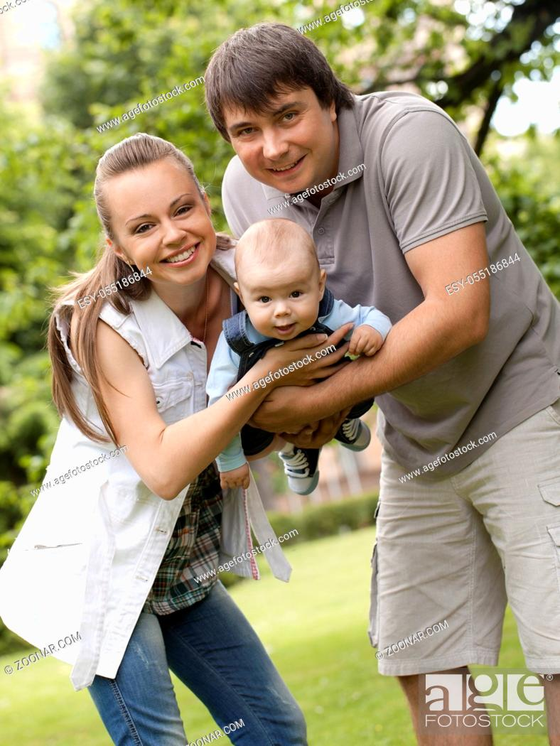 Stock Photo: Young and happy family get stroll in the park.