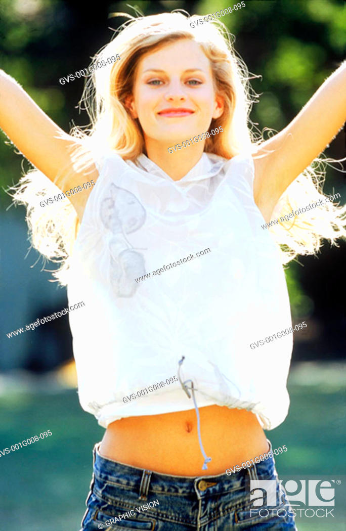 Stock Photo: Portrait of a young woman with her hands in the air.