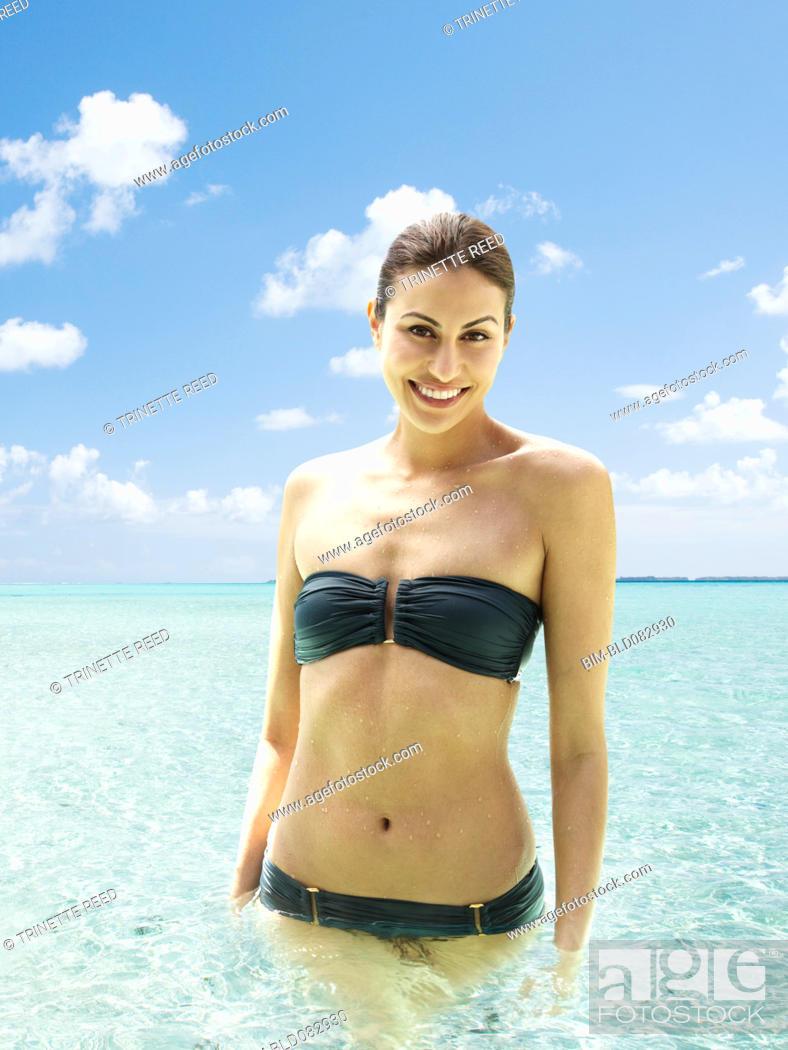 Stock Photo: Mixed race woman standing in ocean.
