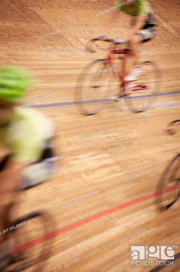 Stock Photo: Blurred motion of cyclists racing on track.
