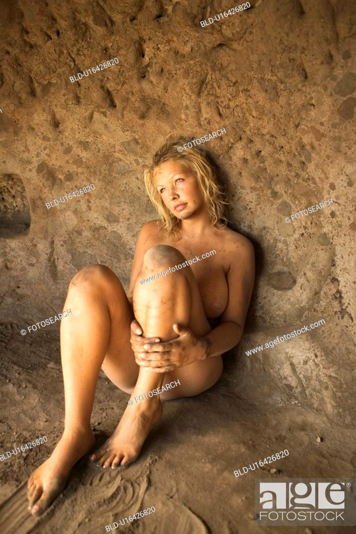 Stock Photo: Nude female sitting in a cave.